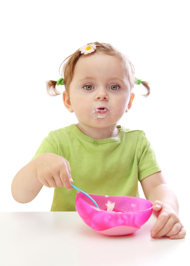 Download Baby Girl Eating Yoghurt Royalty Free Stock Images - Image: 11449409