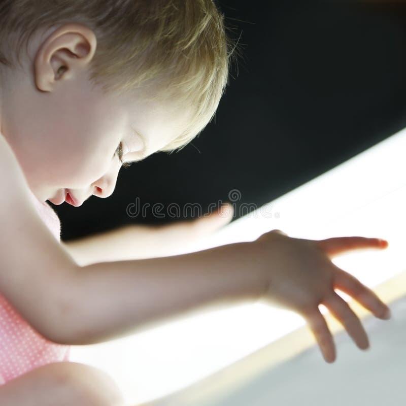 Baby girl exploring the light