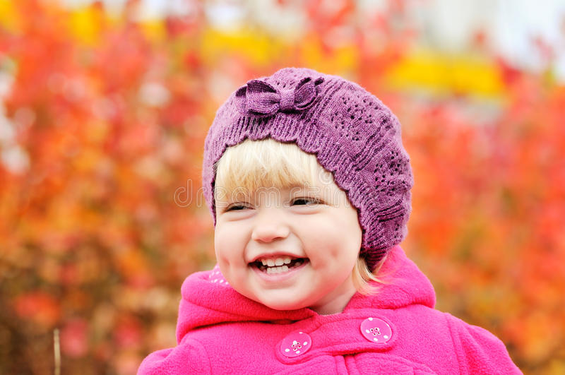 Baby girl in fall. Baby girl smiling with dimple cheeks royalty free stock photography