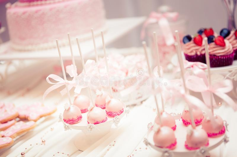 Baby girl first birthday party - stylish table set. Table set for baby girl first birthday party with candy theme stock photos