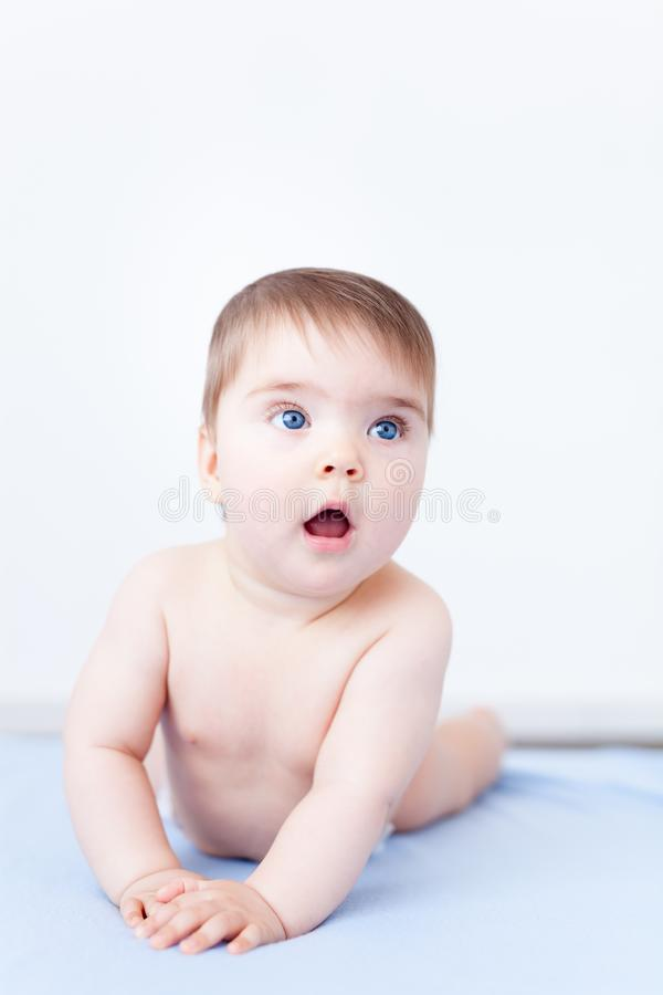 Baby girl gasping in surprise royalty free stock photography