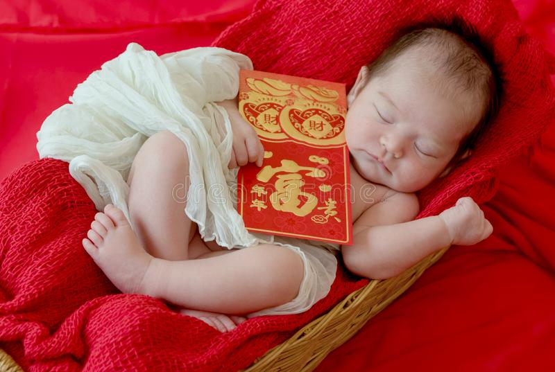 baby girl with gesture of happy chinese new year stock photo