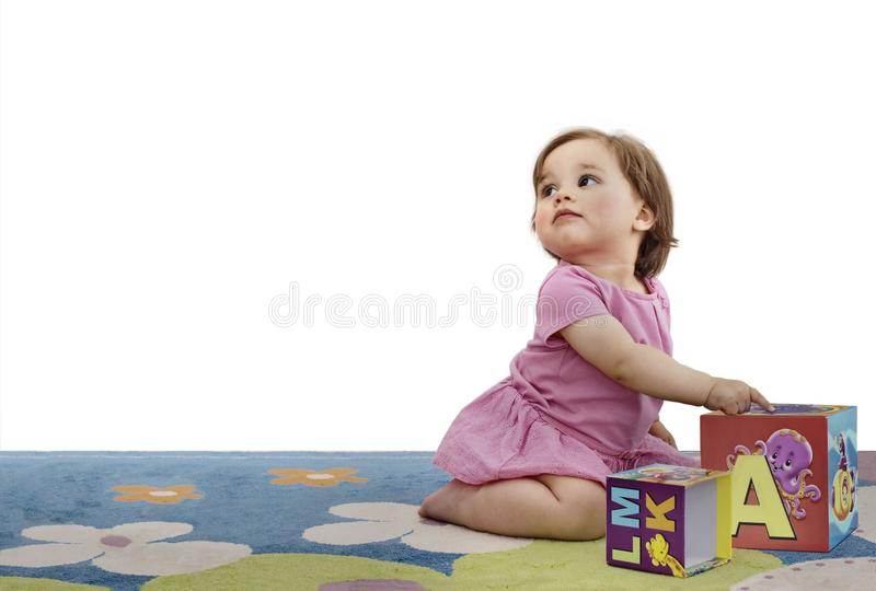Baby Girl Gets Acquainted With Letters stock photography