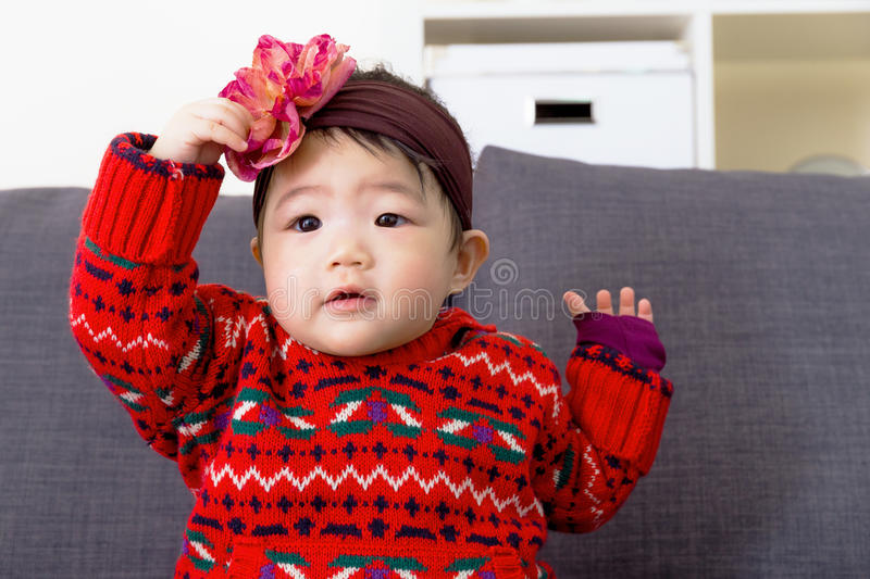 Baby girl with hair accessory stock images