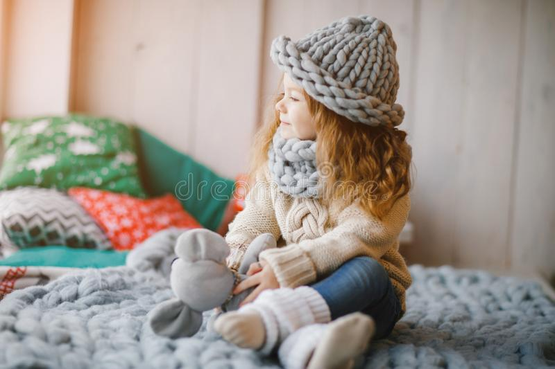 Baby girl in knitted hat and scarf. Baby girl a hand made knitted hat and scarf royalty free stock photo