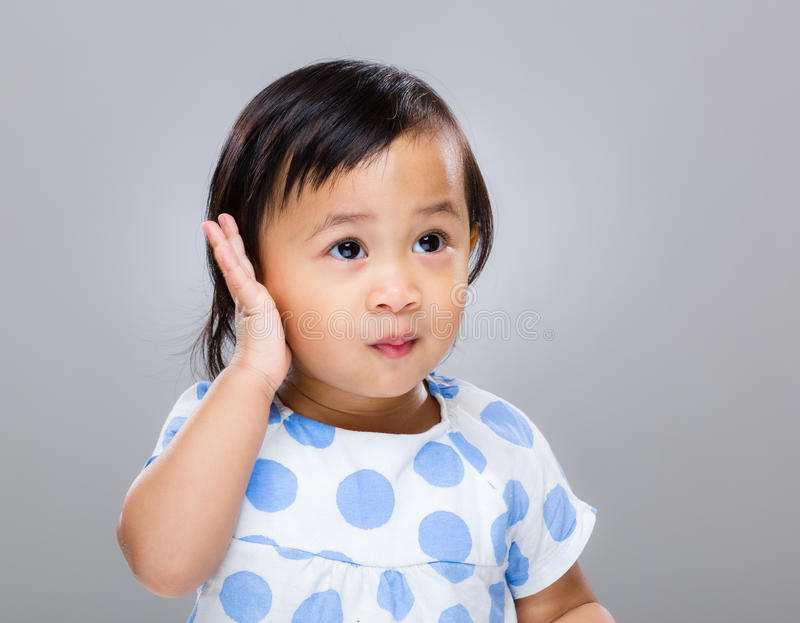 Baby girl hand touch ear stock image. Image of african - 41305023
