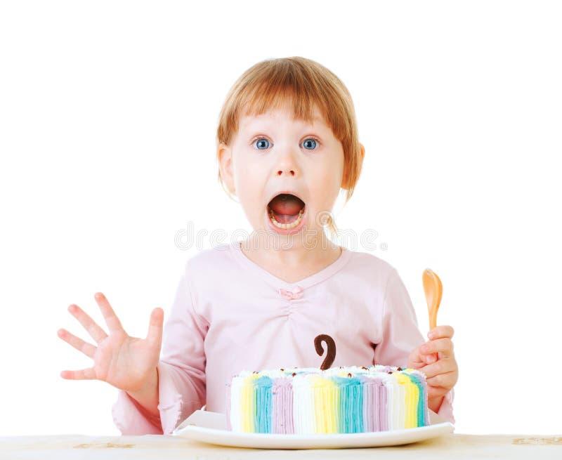 Baby girl and her birthday cake. Studio royalty free stock image
