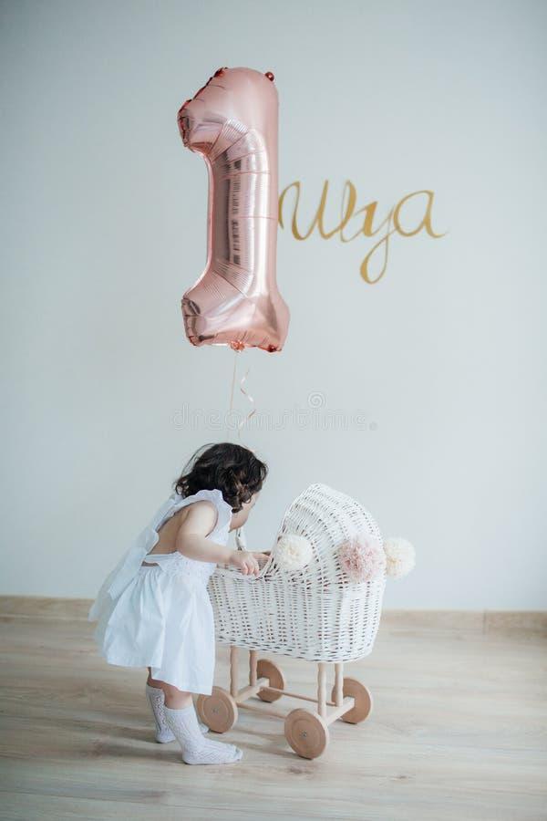 Baby girl in her birthday royalty free stock photos