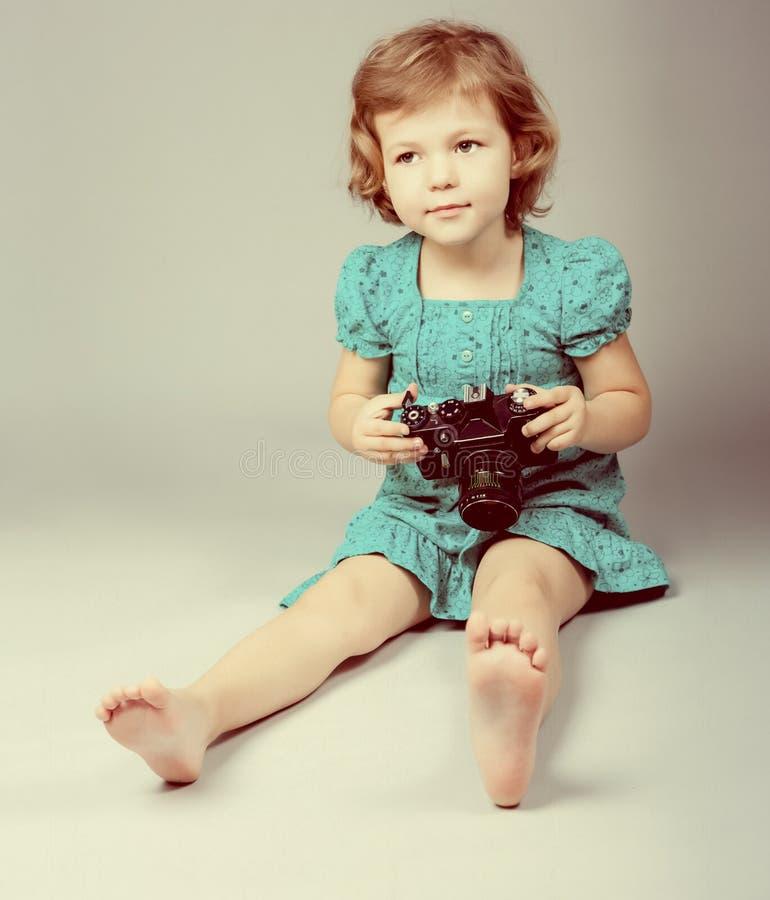 Download Baby Girl Holding Photo Camera Stock Image - Image: 24271653