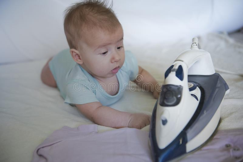 Baby girl ironing royalty free stock photography