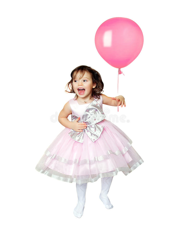 Baby girl jumping with toy balloon. Isolated royalty free stock photography