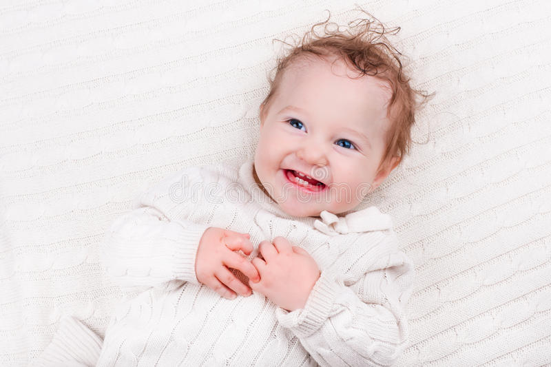 Baby girl on knitted blanket royalty free stock images