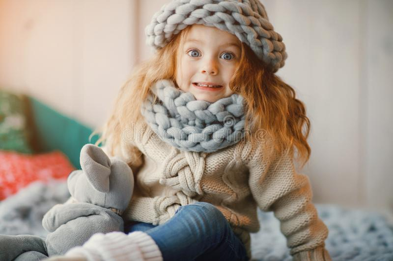 Baby girl in knitted hat and scarf royalty free stock photos