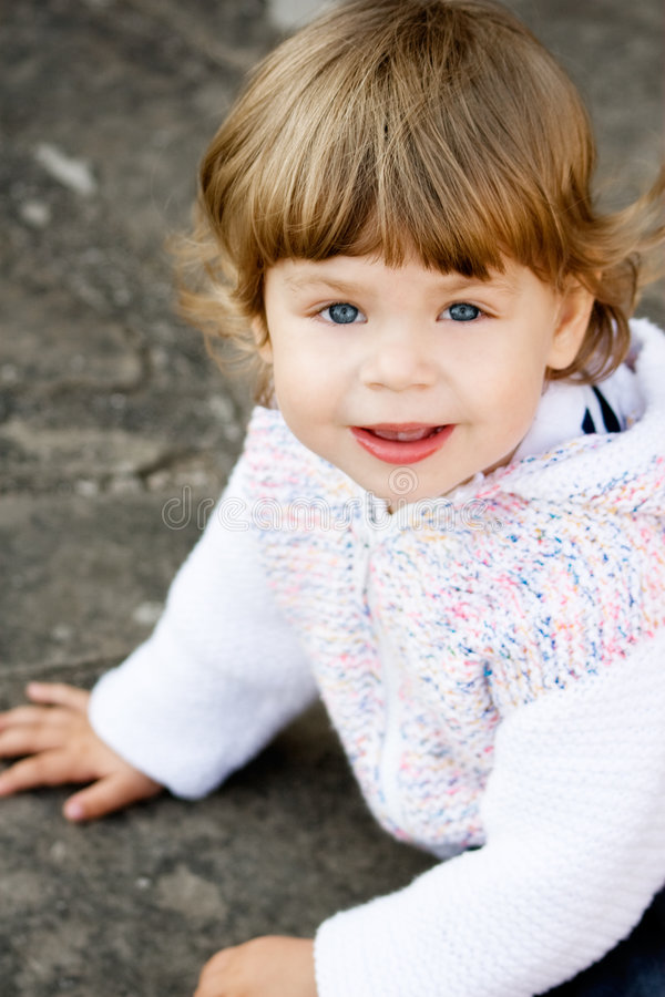 Baby Girl in Knitted White Cardigan