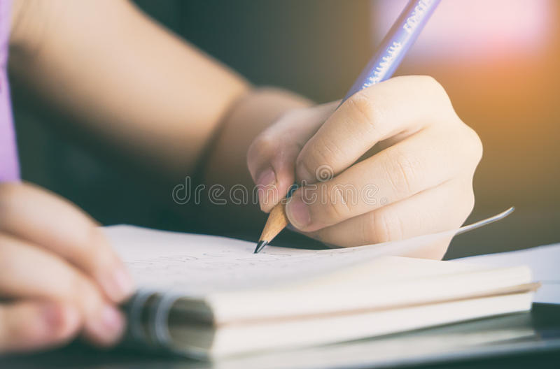 Baby girl is learning how to write royalty free stock photography