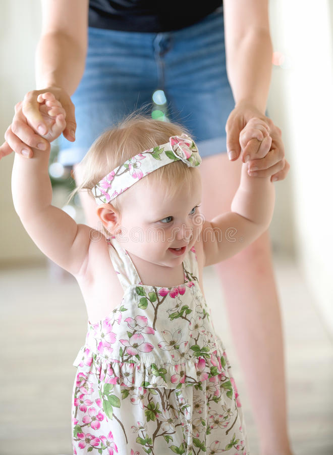 Baby girl learning to walk royalty free stock photo