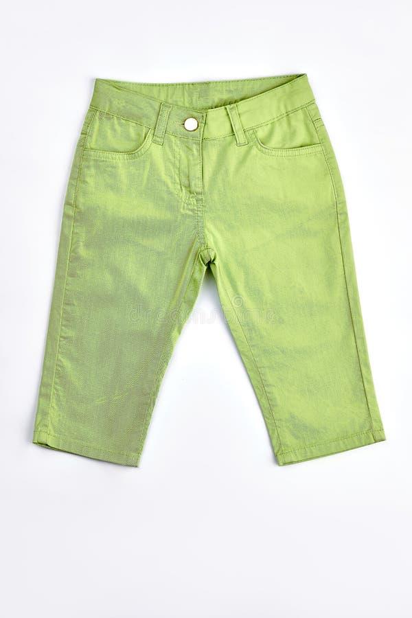 Baby-girl light green cotton breeches. Newborn baby girl light green cotton trousers on sale. Kids high quality modern apparel royalty free stock photo