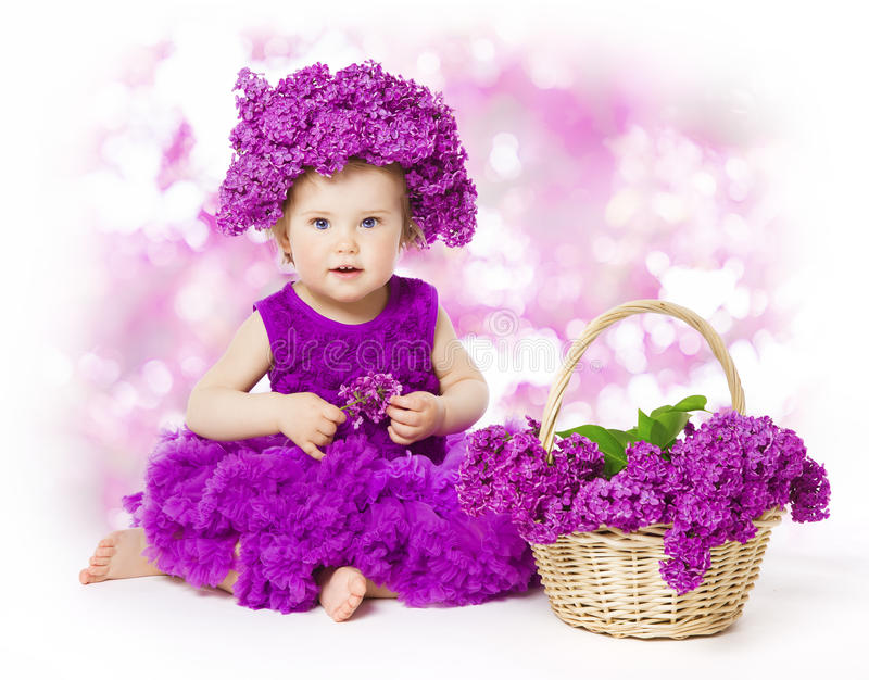 Baby Girl Lilac Flowers, Little Kid in Flower, Child Bouquet stock photography