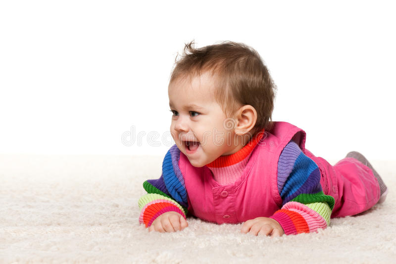Download Baby Girl Is Lying On The Carpet Stock Image - Image: 23754063