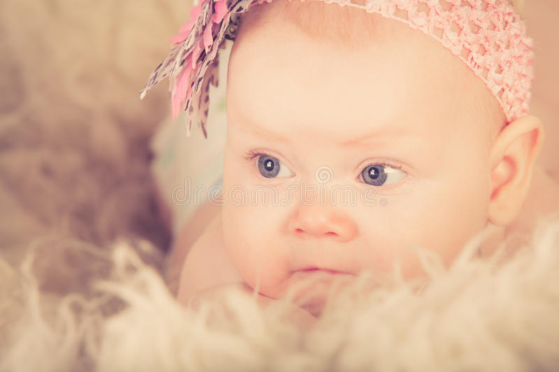 Download A baby girl stock photo. Image of expression, posing - 34361402