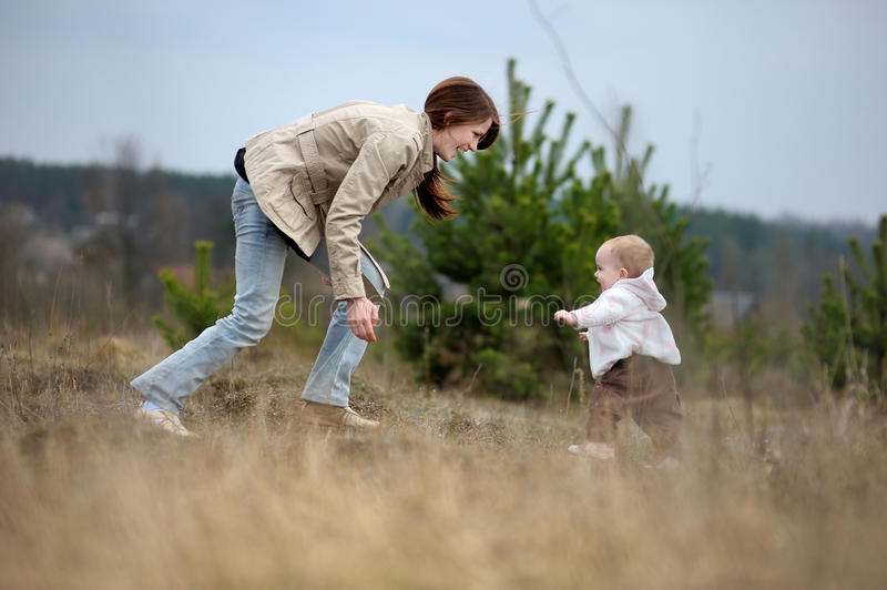 Download Baby Girl Making Her First Steps Stock Photo - Image: 13837376