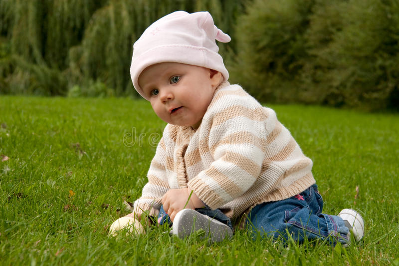Baby girl in meadow royalty free stock photo