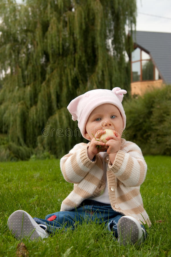 Baby girl in meadow stock photo