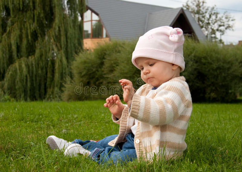 Baby girl in meadow stock image