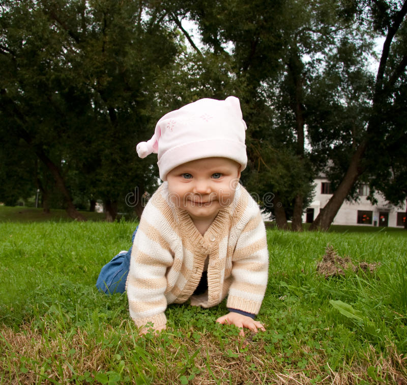 Baby girl in meadow stock images