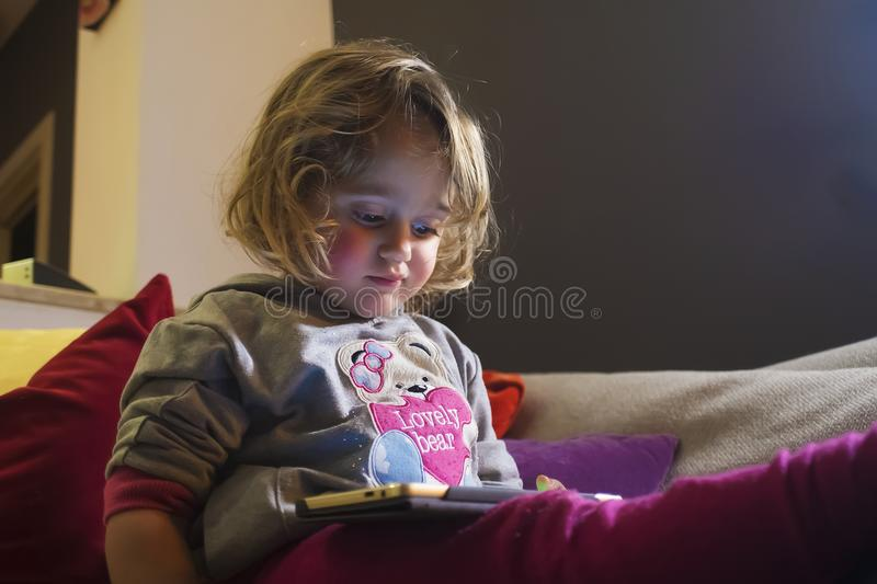 Baby girl and mobile phone royalty free stock photos
