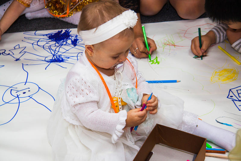 Baby Girl with mom at Drawing lesson stock photos