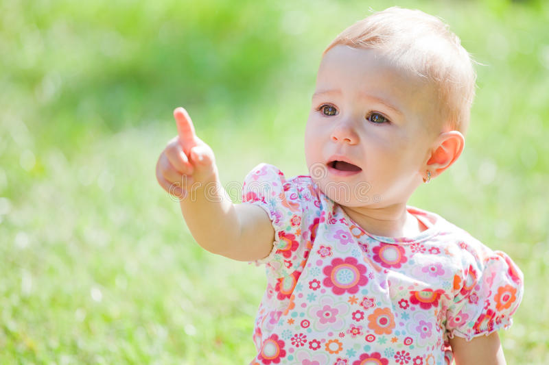Baby girl outdoor royalty free stock photography