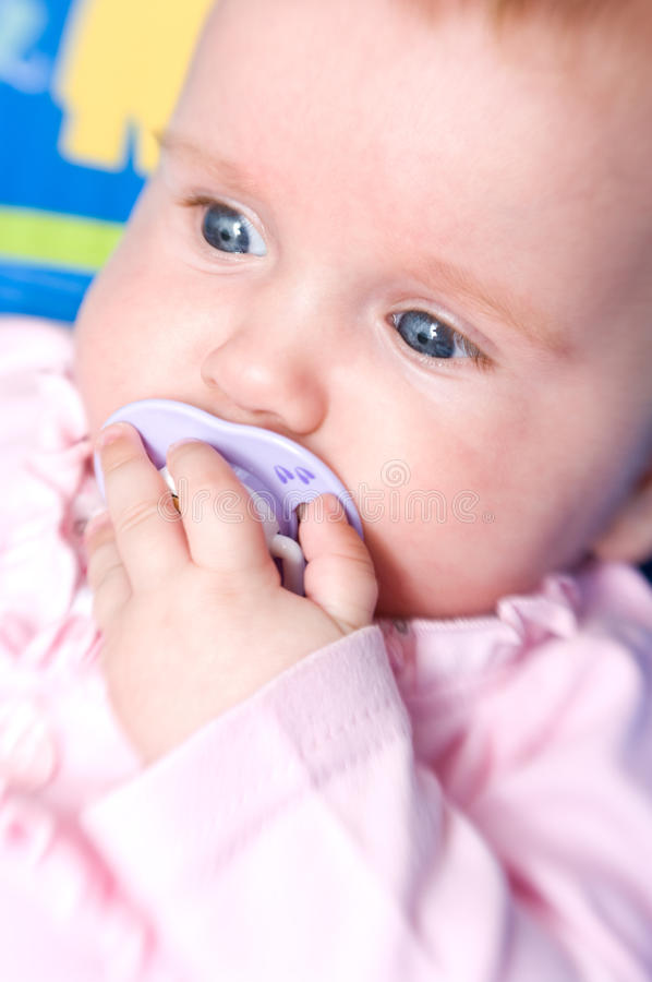Download Baby girl with pacifier stock photo. Image of contentment - 15531068