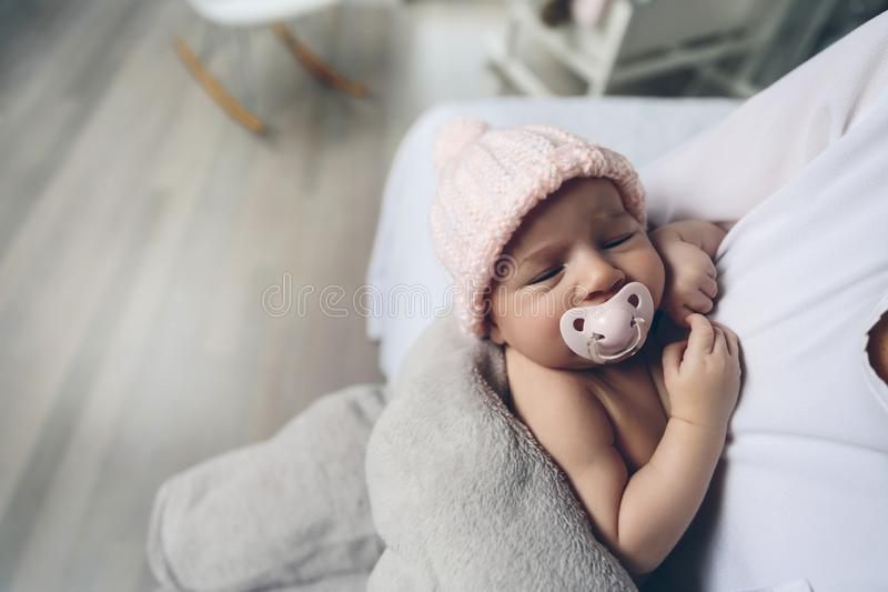 Baby girl with pacifier sleeping stock photography