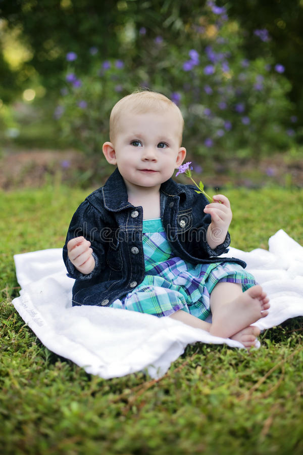 Baby girl in park royalty free stock images