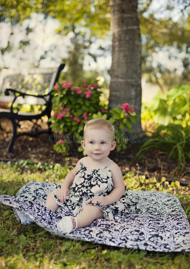Download Baby girl in park stock photo. Image of smell, nature - 21949744