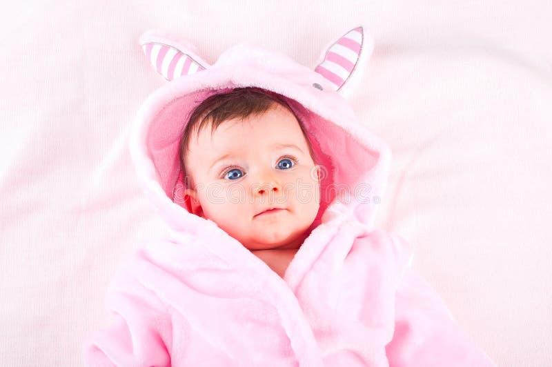 Baby girl in pink bathrobe. Image of baby girl in pink bathrobe stock images