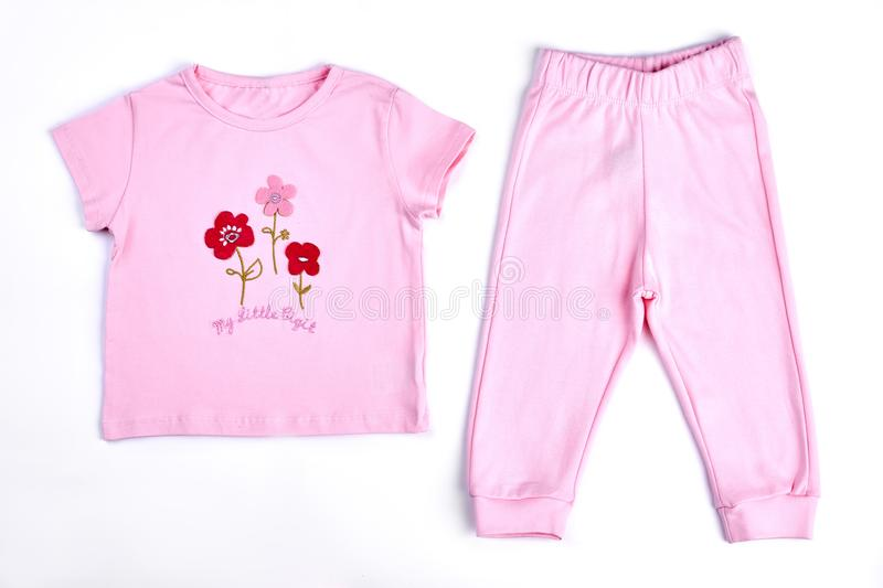 Baby-girl pink t-shirt and trousers. royalty free stock photography