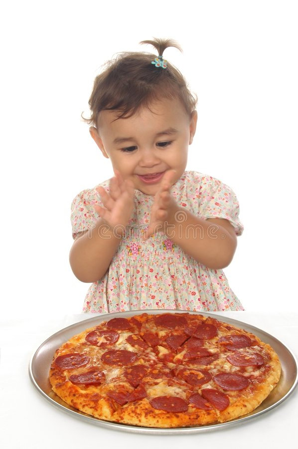 Baby girl and pizza stock images