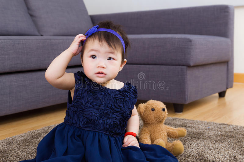 Baby girl play doll royalty free stock photos