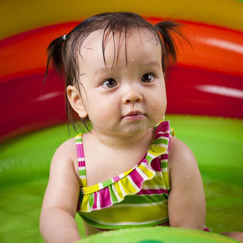 Download Baby girl playin in water stock photo. Image of small - 19823280