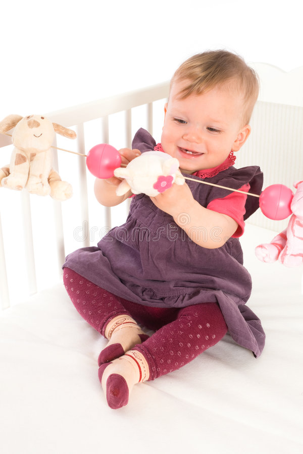 Baby Girl playing in bed royalty free stock photos