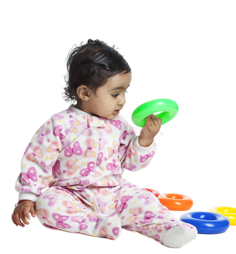 Download Baby Girl Playing With Colorful Rings Royalty Free Stock Images - Image: 16686029