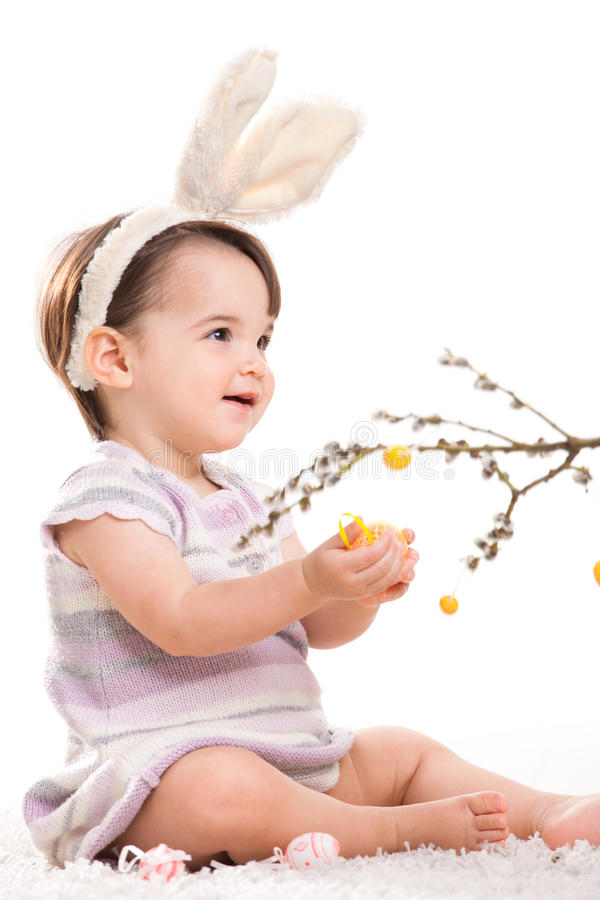 Baby girl playing with easter eggs stock photo