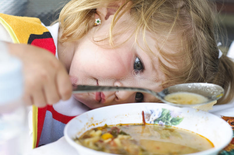 Baby girl playing with food royalty free stock images