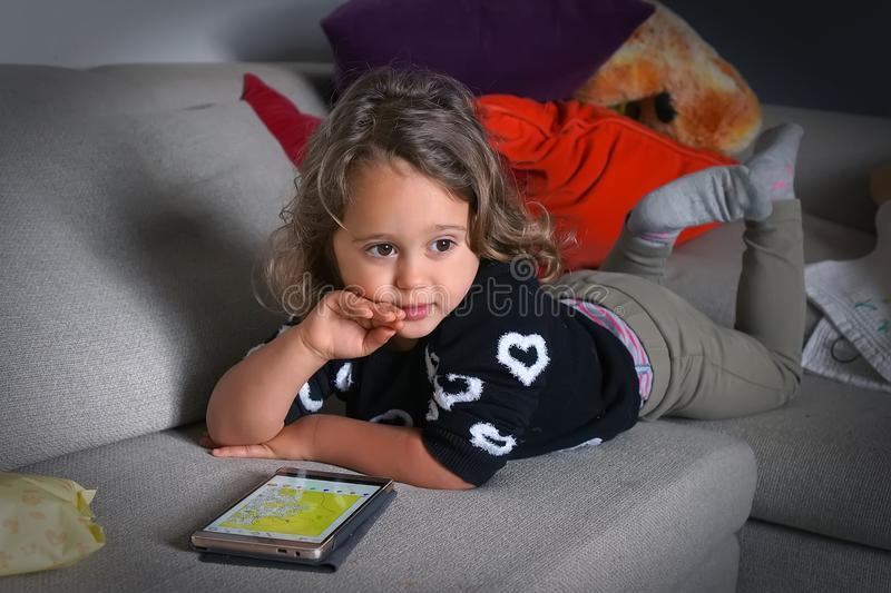 Baby Girl and Mobile Phone royalty free stock images