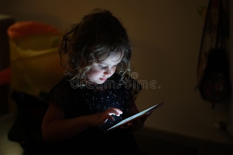 Baby Girl and Mobile Phone royalty free stock image