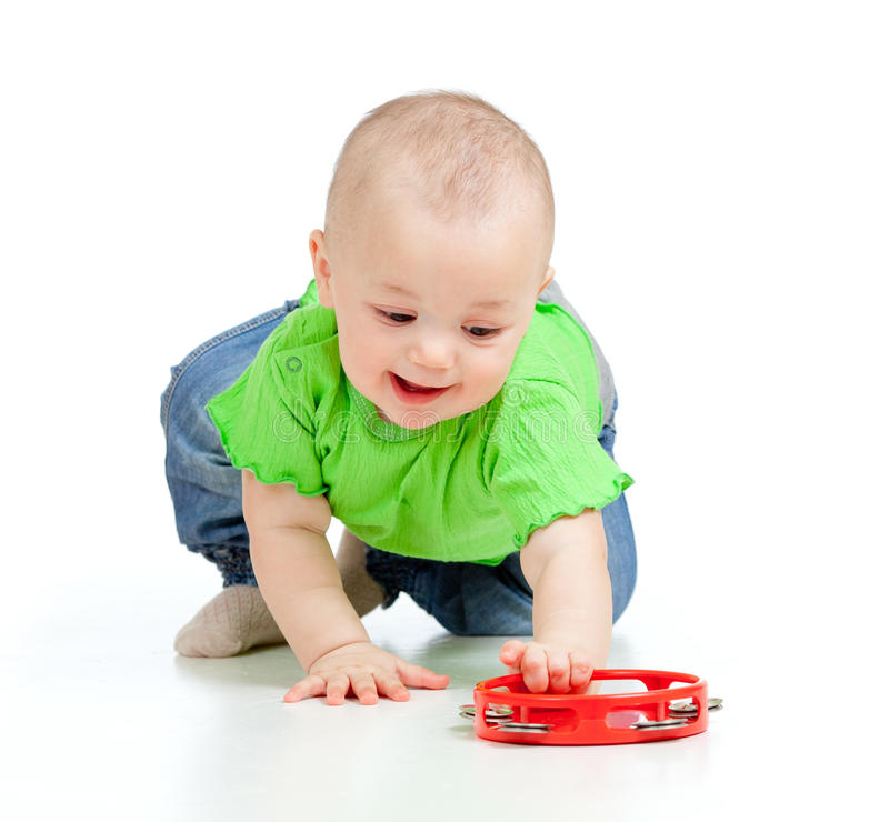 Baby girl playing with musical toy. Child playing with musical toy on white background royalty free stock image