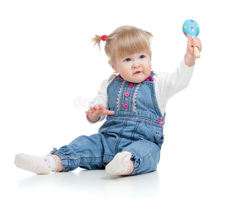 Baby girl playing with musical toys stock photography