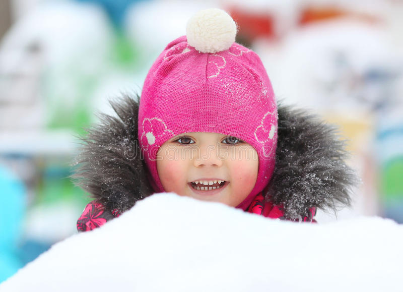 Baby girl playing in the snow stock photography